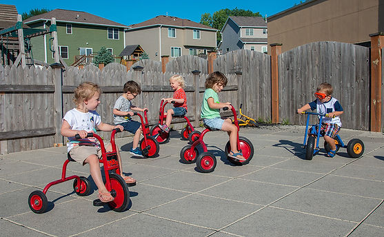 Kids on trikes on rubber surface at Kelly's Kids Highlands loction