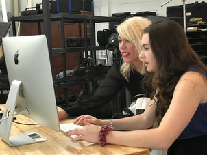 Madison and Jen reviewing images