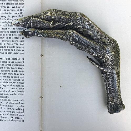 Brass Swans feet / Fiona Dean