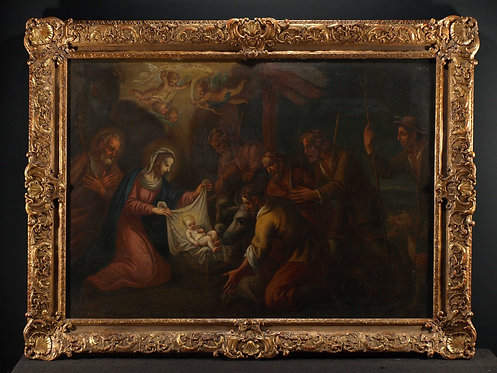 A large oil on canvas manger scene in a guilded frame  (G27)