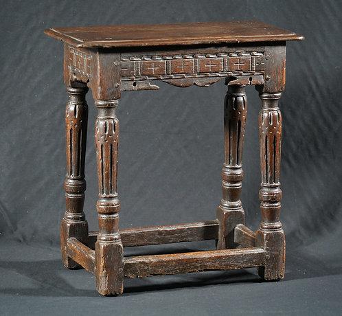 An Elizabeth I joined oak stool, late 16th century
