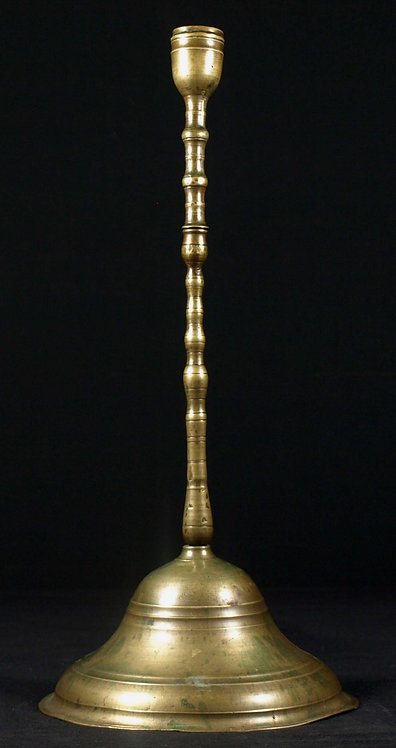 A brass candlestick (possibly middle eastern), 17th/18th century  (J10)