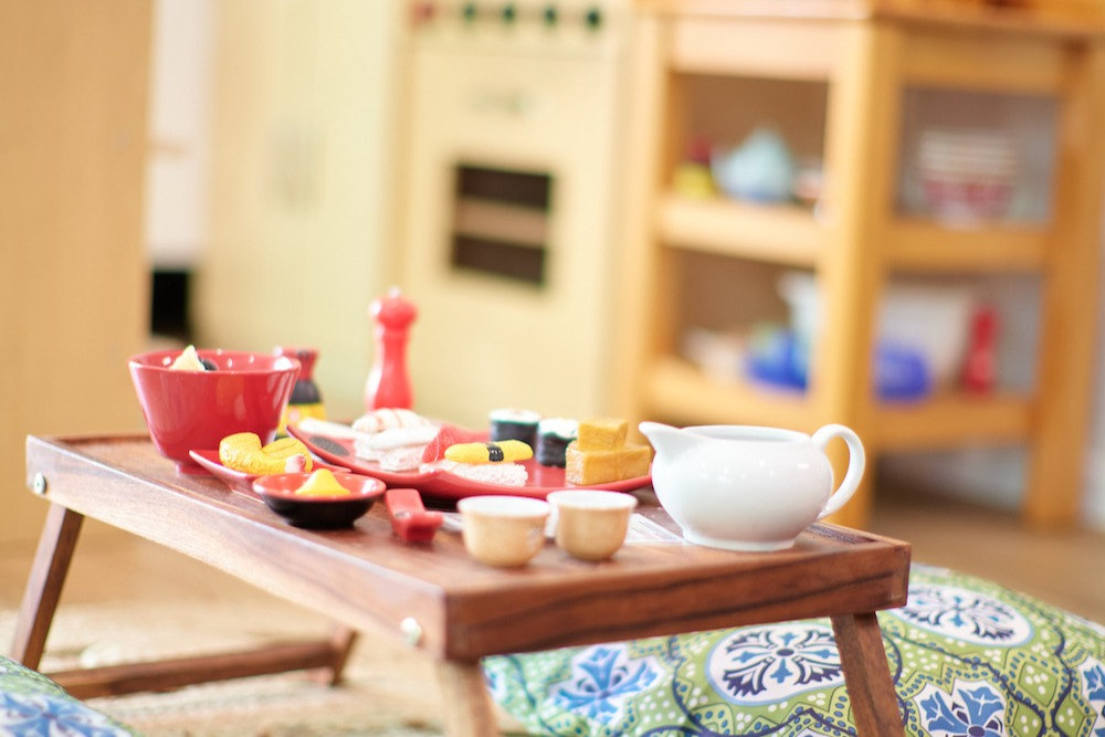 Children's pretend sushi set on mini table in play kitchen