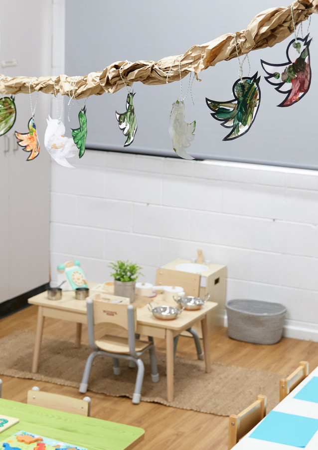 Table and chairs in child care room with decoration