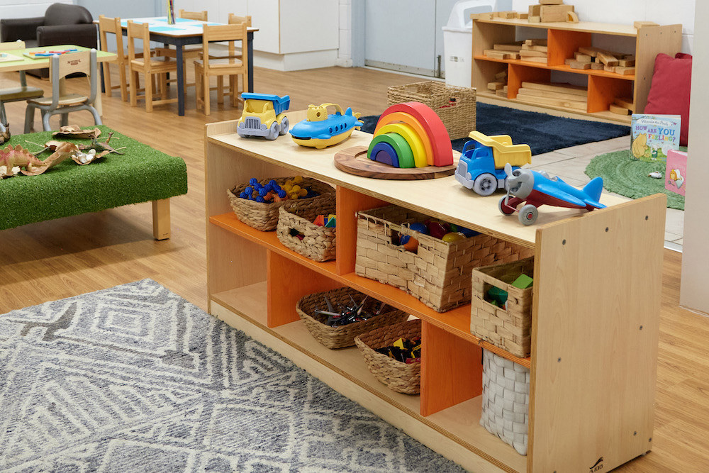 Shelf with baskets and toys in Foundations Early Learning