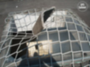 broken skylight with debris caugth in SPS safety net