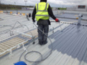 Man working on fragile roof surface with safety protection roof net frame SPS Safenet