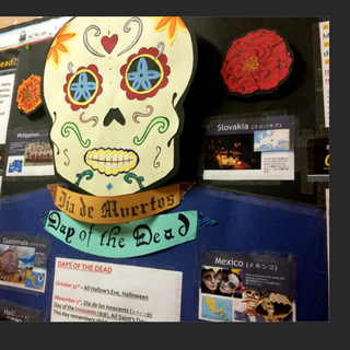 """""""Jackie's Corner""""-Day of the Dead [Dia de los Muertos] display. Construction paper and ink. (ジャッキー's コーナー「死者の日」のディスプレイ 色画用紙・インク)"""