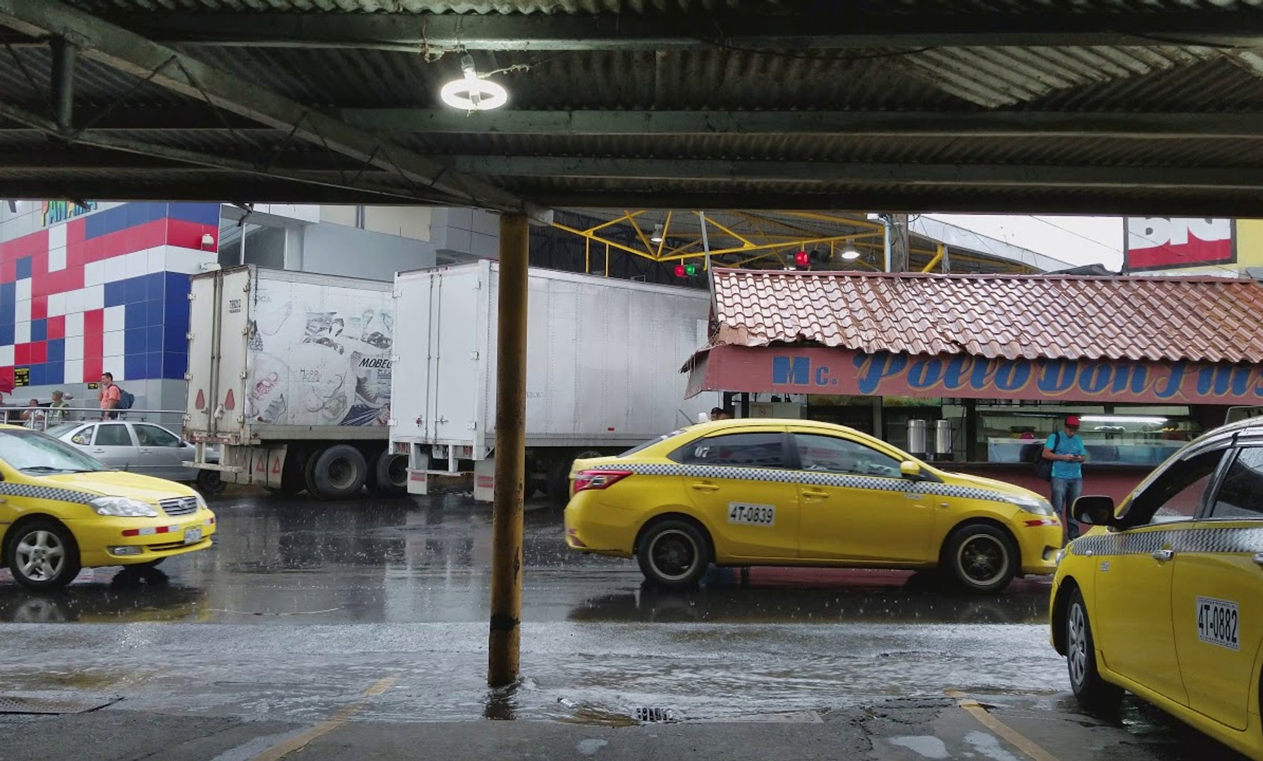 Afternoon Rains from the Panama Taxi Stand at Paso Canoas, Panama