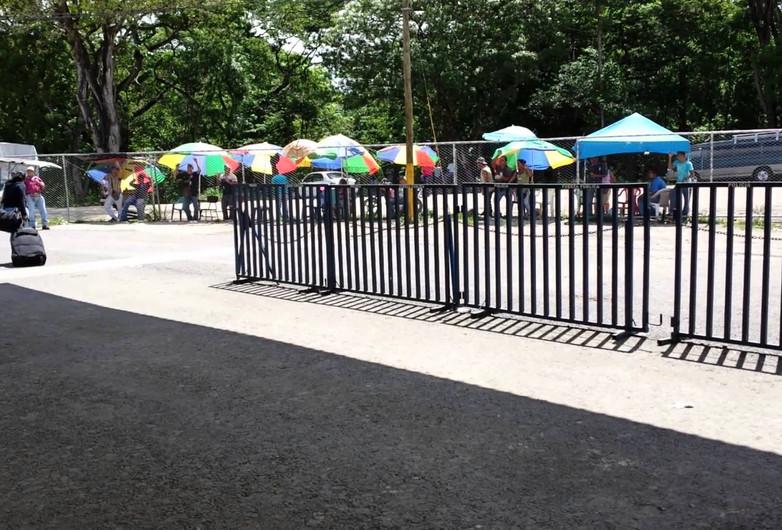 Taxistas Call to Border Crossers at the Penas Blancas Border Crossing; Costa Rica/Nicaragua