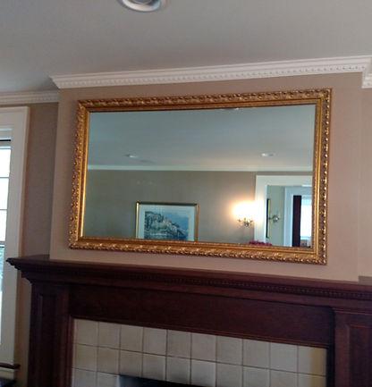 Television framed behind a 2-way mirror