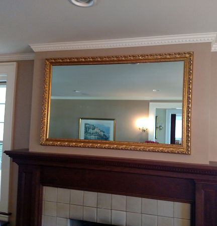 Television framed behind a 2-way mirror
