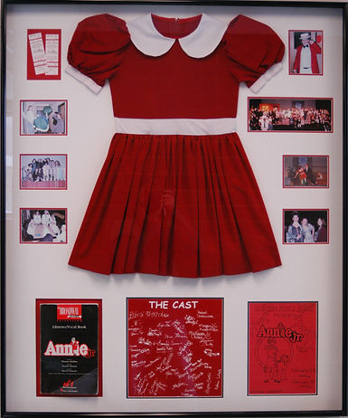 Framed Annie dress and playbill