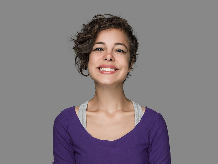 BIPOC woman with short hair smiling