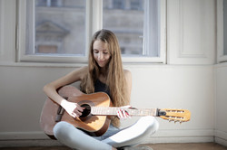 woman-playing-brown-acoustic-guitar-3794