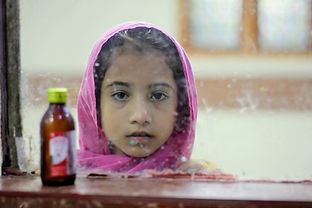 Photo by photographer Pearl Gan of young child in Indonesia, living in a community where Malaria is part of daily life