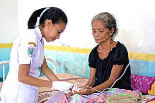 Photo by photographer Pearl Gan of woman receiving treatment at a health centre