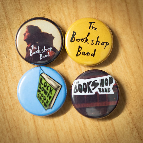 Set of four 25mm pin badges in a little pouch.