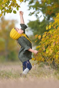 Child interacting with nature photo