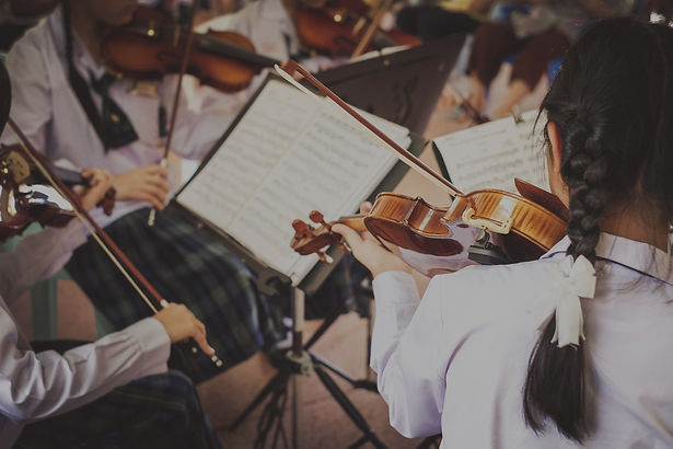 girl students playing violin in the group._edited.jpg