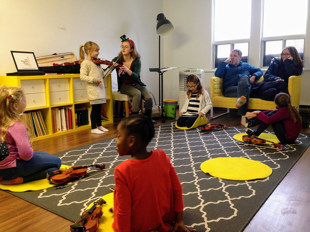 A Suzuki violin group class at Upper Beaches Music School in East Toronto on Danforth