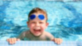 bigstock-Happy-Child-In-A-Swimming-Pool-4868383-2.jpg
