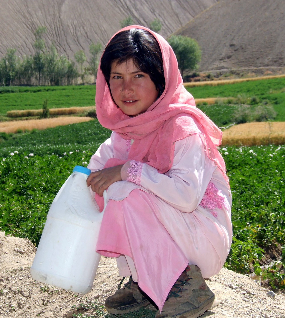 Fatima, a Hazara girl from Bamiyan Afghanistan, collects water at the well.