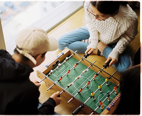 man and woman playing foosball table_edited_edited.jpg