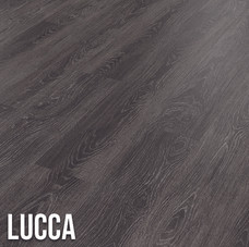 Lucca is ideal if you are looking to make a statement.  The deep oak effect boasts dark blue and black tones, while silvery grey highlights emphasise the intricate grain details.  This design works well in both contemporary and traditional interiors. 1220 x 179mm (plank)