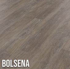 Bolsena offers a contemporary oak effect, mixing deep brown with silvery charcoal to create a decadent, yet on-trent floor.  Intricate oak detailing and a subtle textured surface bring authenticity to the flooring, making it look and feel like a real timber floor. 1220 x 179mm (plank)