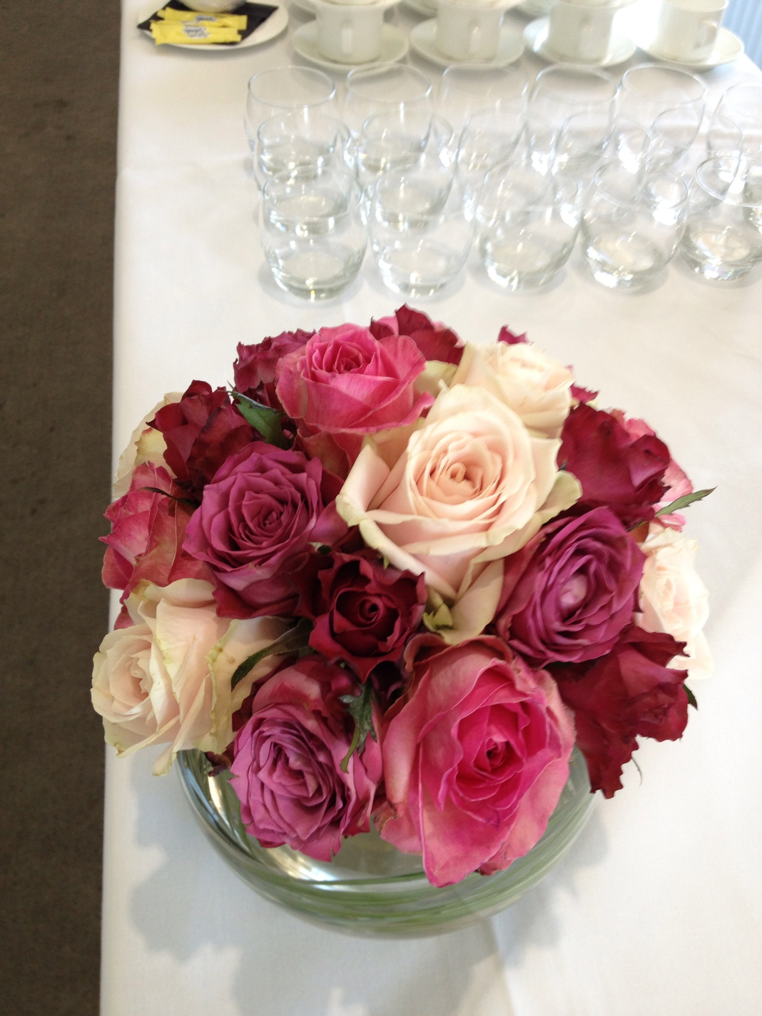 Table design with roses in fishbowl