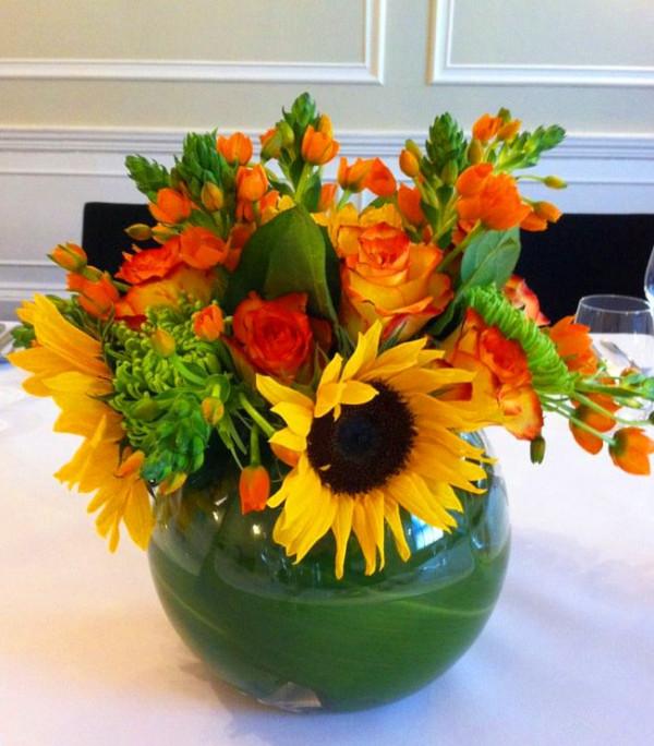 Autumn sun flowers in fish bowl
