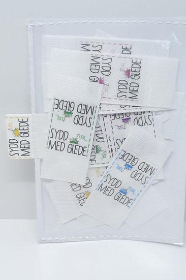 sidesøm label 'sydd med glede'