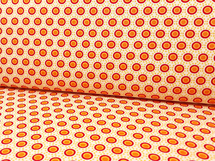 bomullstoff med røde rundinger og prikker i gul og oransje