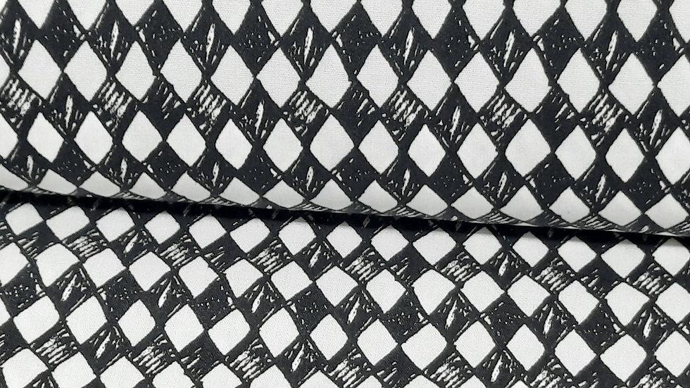 bomullstoff med harlekin ruter i svart/hvit