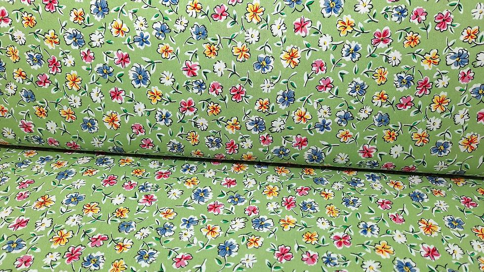 bomullstoff lysegrønn med blomster i blå, gul og rosa