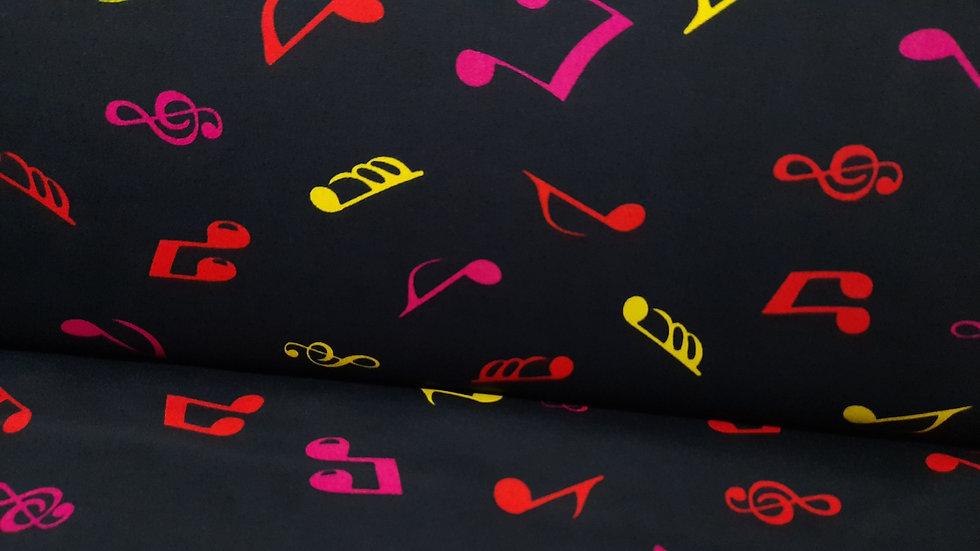 bomullstoff svart med noter i rød, pink og gul