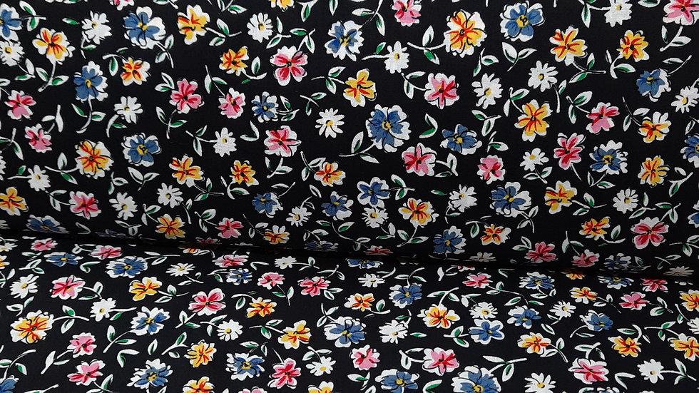 bomullstoff svart med blomster i blå, gul og rosa
