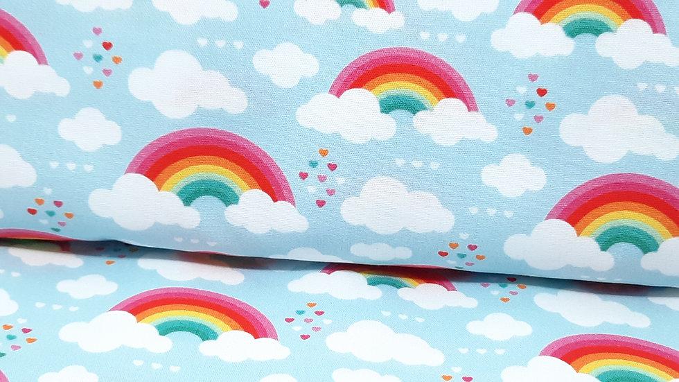 bomullstoff lyseblå med regnbuer, skyer og  hjerter