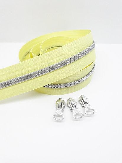 pastell gul glidelås med sølvfarget spiral, metervare