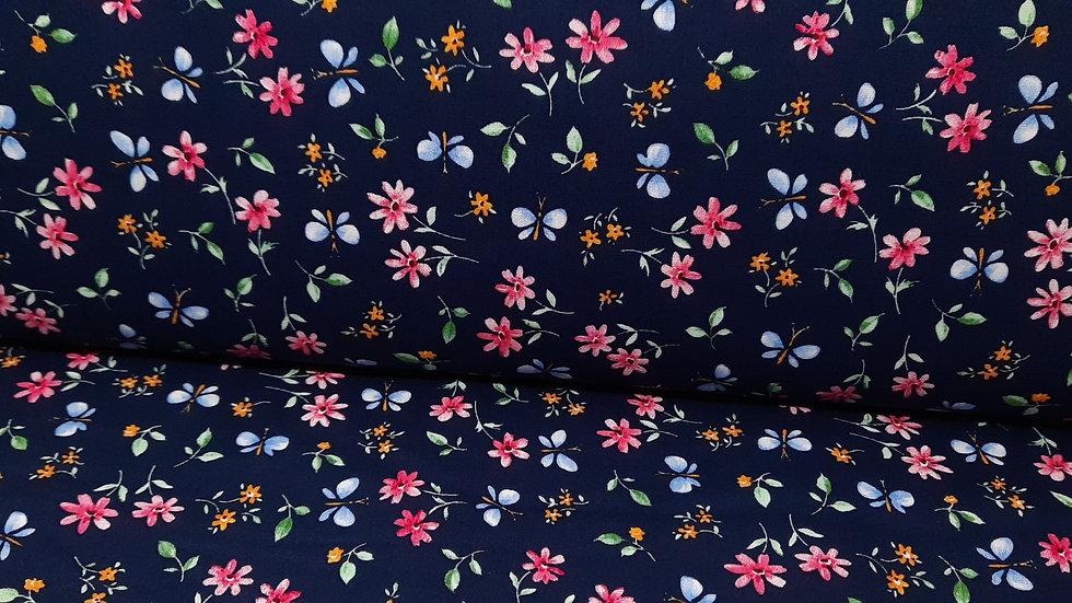 bomullstoff mørkeblå med blomster og sommerfugler