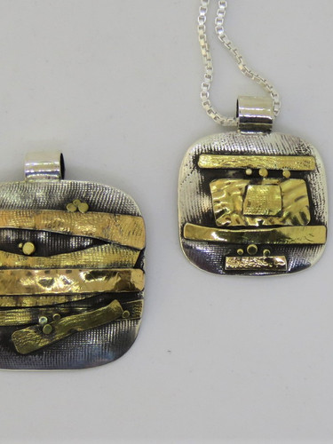 freeform gold and silver pendant