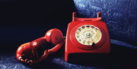 Canva - Red Rotary Telephone On Blue Sof