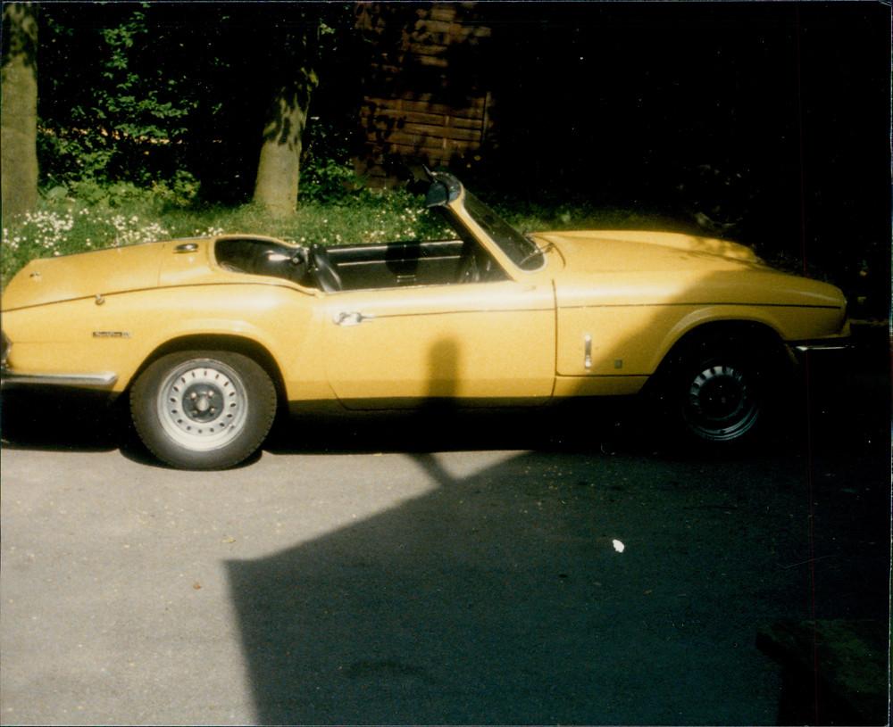 My first car.  Dad got me a Triumph Spitfire.