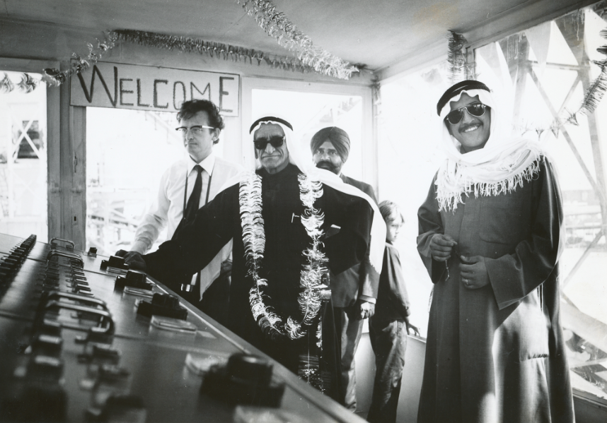 Yusuf Alghanim (with son Omar Kutayba on the right) opens the Sabiyah gravel plant - at the time the world's biggest.  And there is Dad standing next to him, and that little boy in the background is me.  My sister had presented Yusuf with the lei prior to entering the control room.