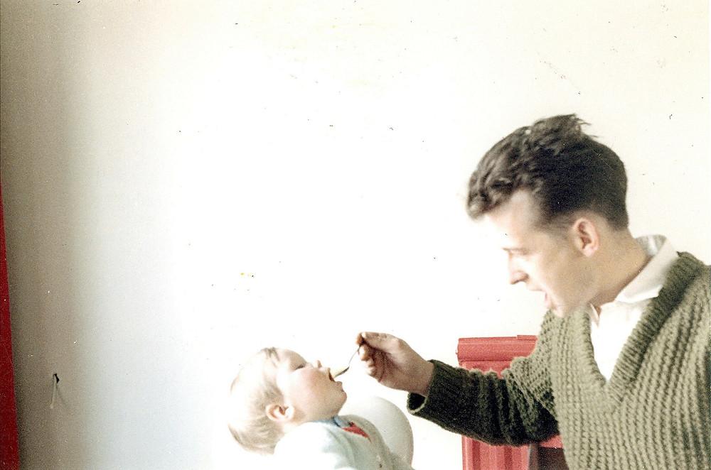 Dad feeding me breakfast in 1963 in 32 Hollywalk Drive, Normanby
