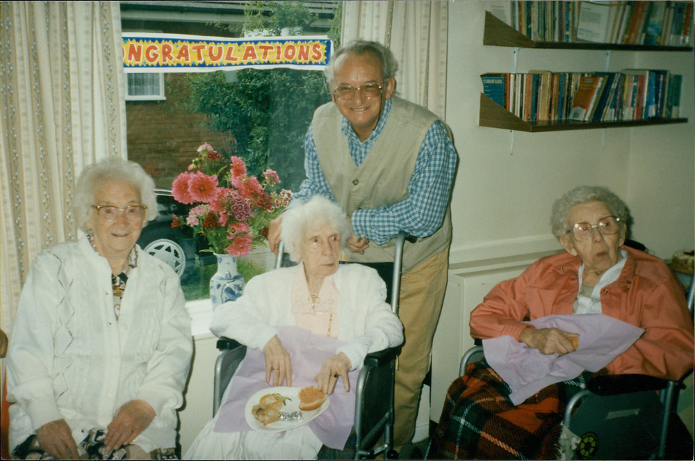 Dad with his mother on her 100th birthday.  Next to Nana are her sisters Elsie and Alice, both of whom would also celebrate their 100th birthday.