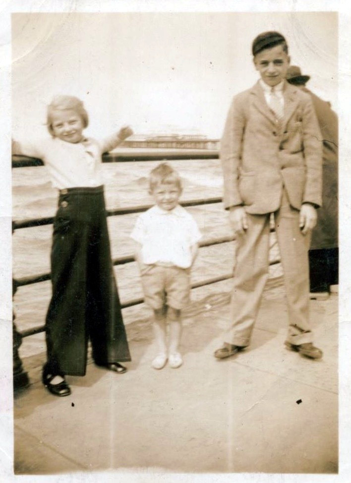 Dad (centre) with his sister Betty and brother Charles circa 1940
