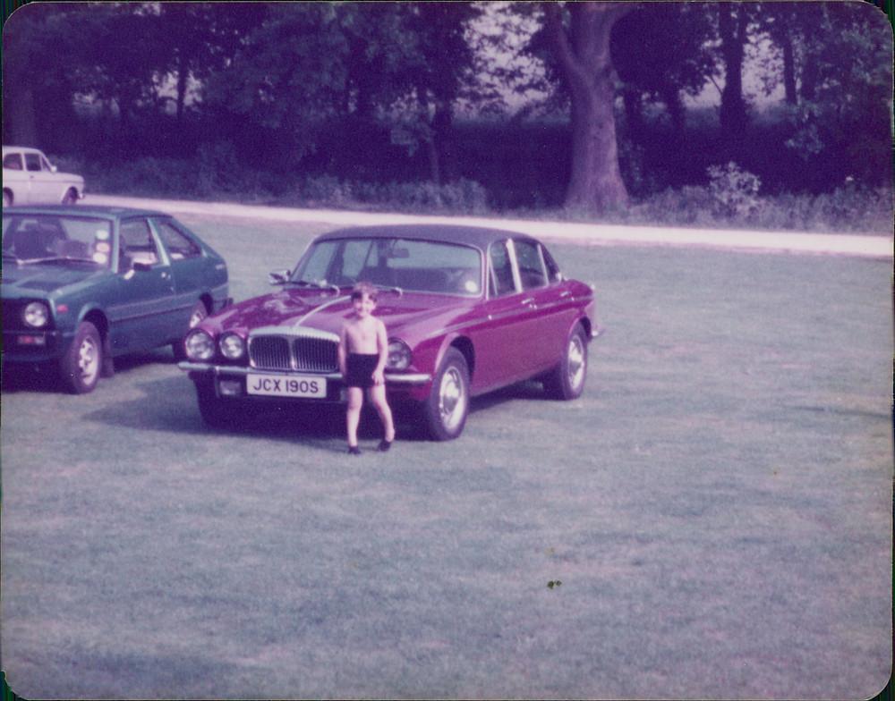 My brother sitting next to Dad's pride and joy - his Daimler Vanden Plas.