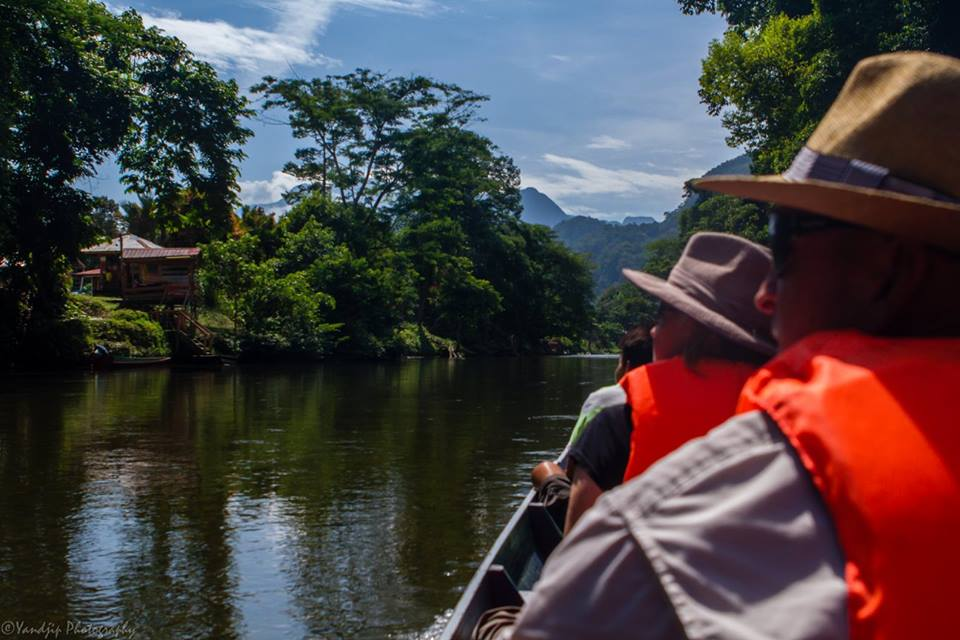 Watch the world unfold as we travel by longboat in Borneo